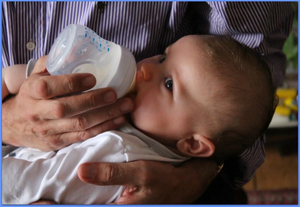 baby feeding on bottle