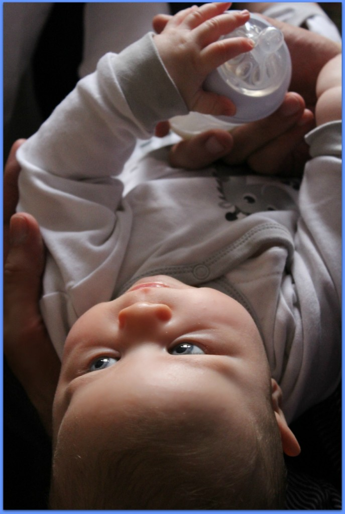 baby with bottle expressing and feeding