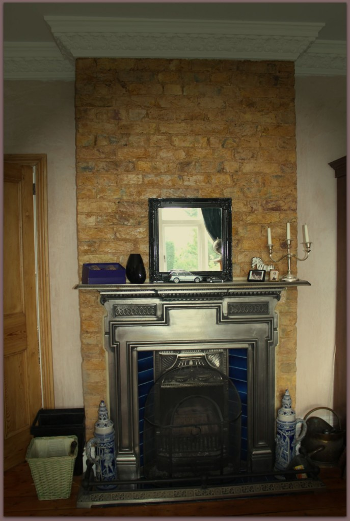 Victorian fireplace with bare brickwork