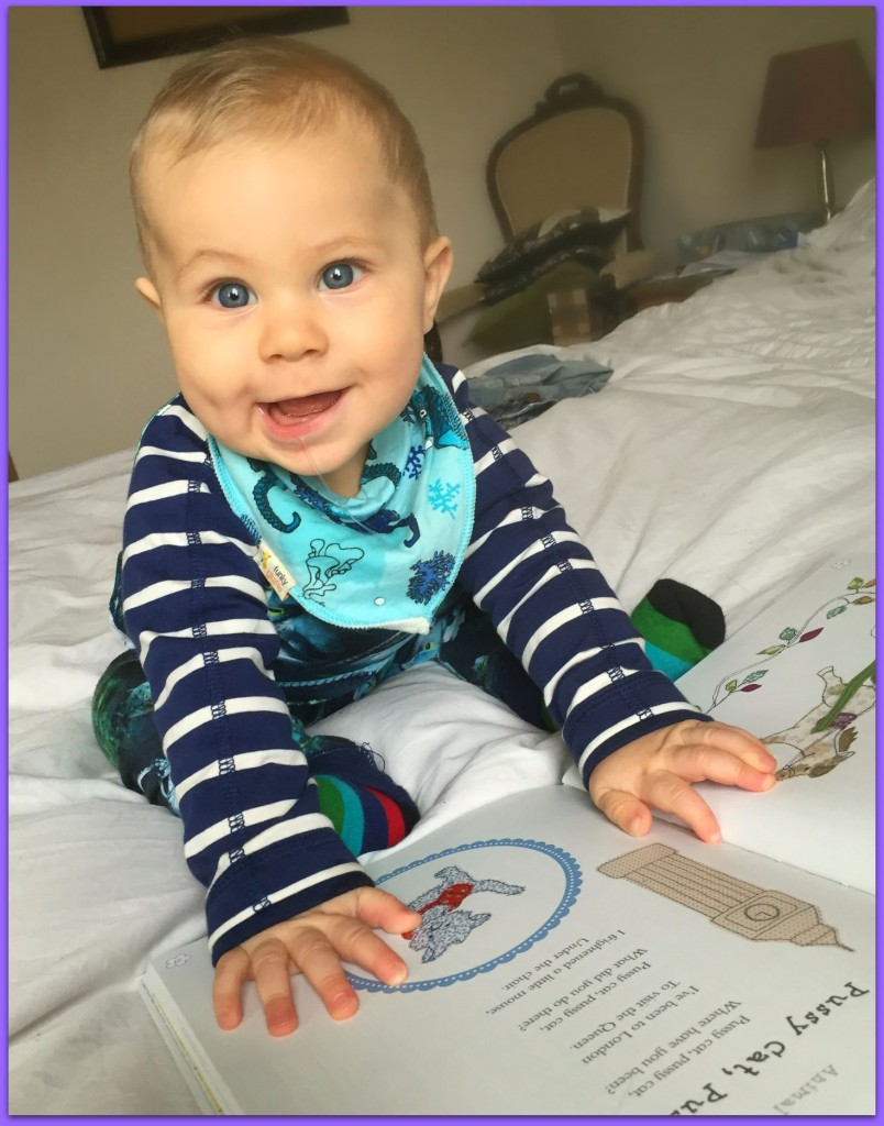 Caspian enjoying A Collection of Nursery Rhymes from Parragon Books Cute As a Button Range