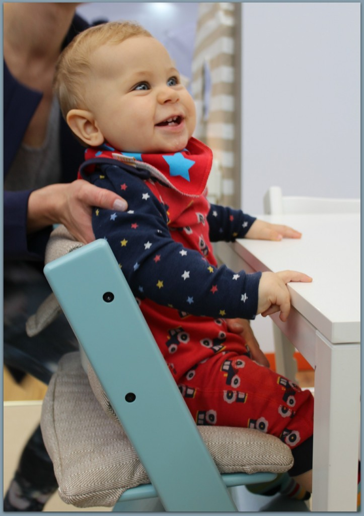 Caspian testing the classic Stokke chair at The Baby Show at Kensington Olympia
