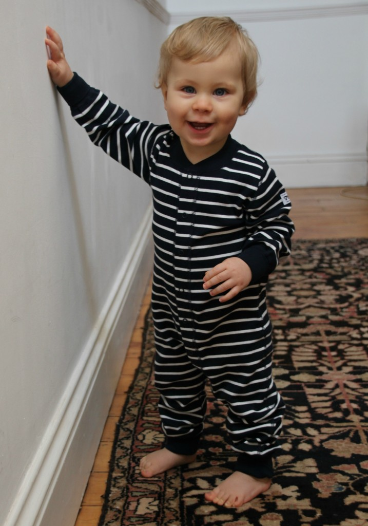 Caspian modelling a navy striped romper for Swedish brand Polarn O. Pyret