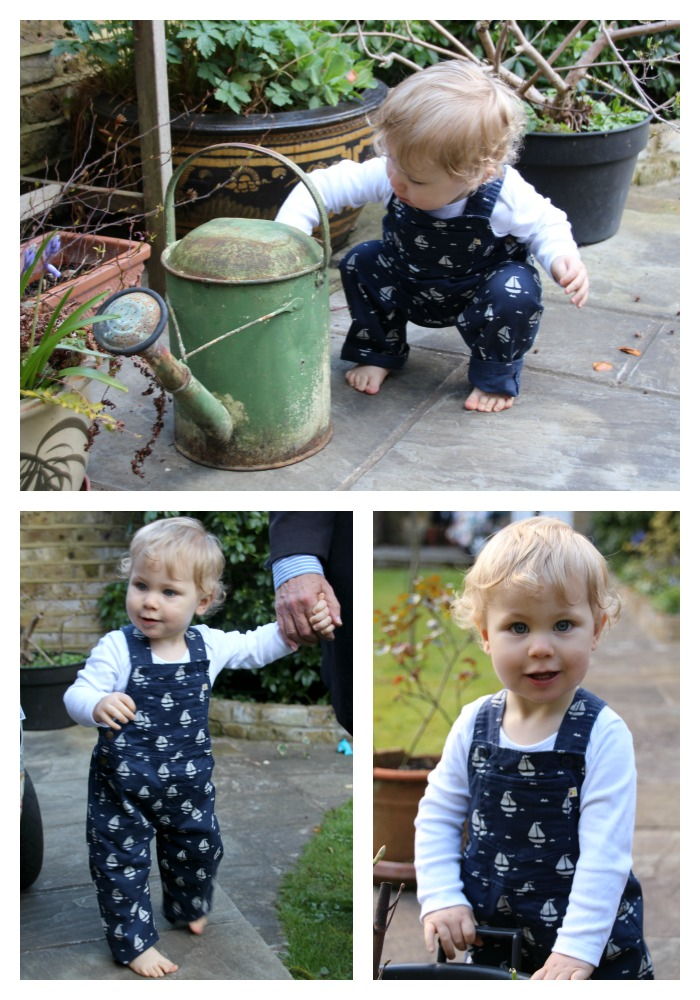 Caspian is exploring the garden in new season dungarees from Frugi