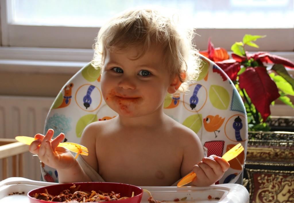 Caspian loving his meatballs and pasta for dinner