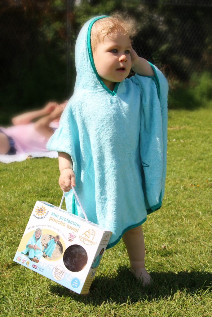 Caspian modelling the Cuddledry poncho while Daddy Long Legs enjoyed the sunshine