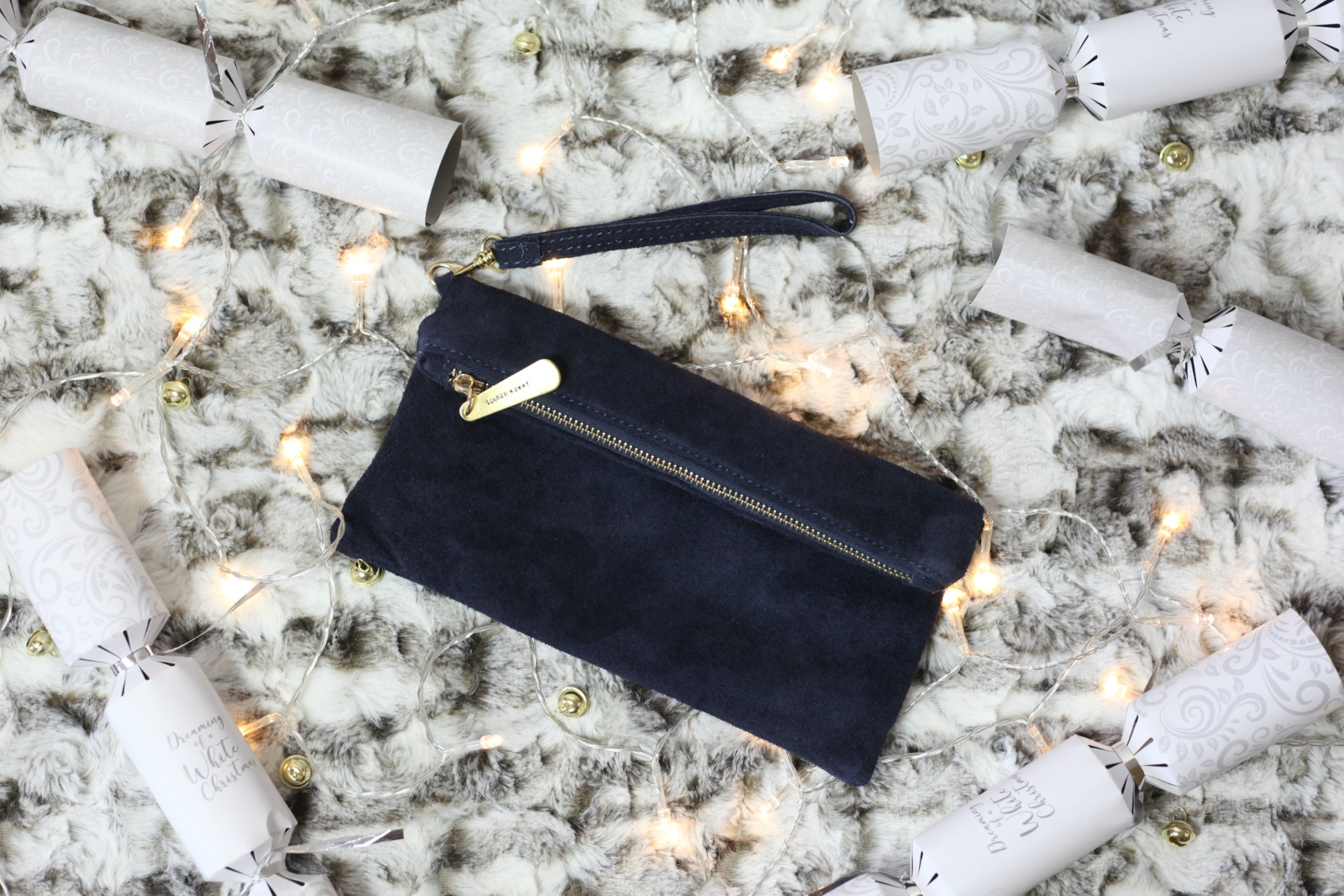 Luxurious Christmas gift ideas from Prezzybox like this personalised suede clutch