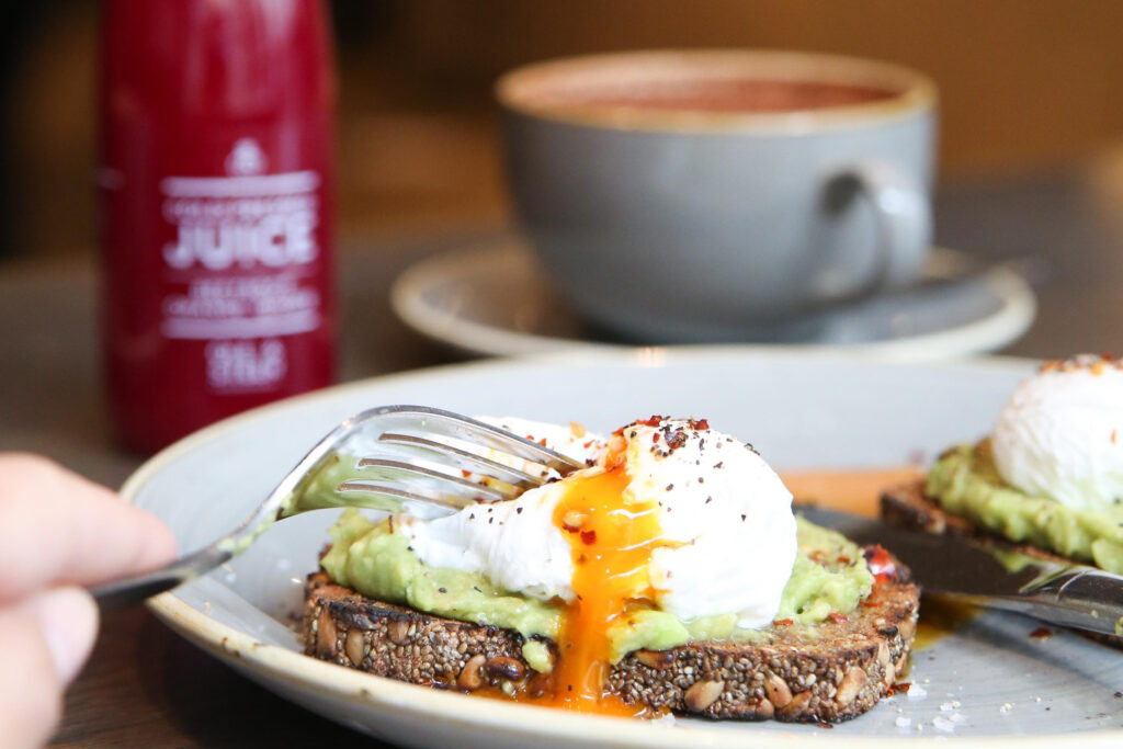 Poached egg on smashed avocado and chia rye as the best Scandinavian brunch in London